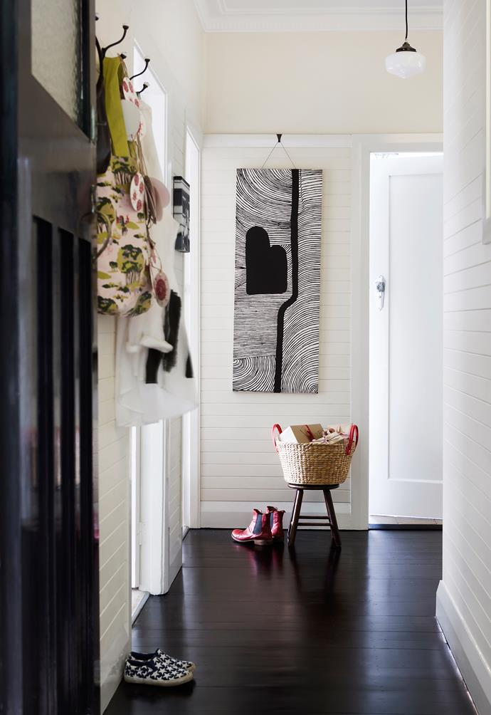 """Berry-red accessories are used liberally within the black and white country-inspired interior palette. Spring Meadows **tote** (beside door) from [Mozi](http://www.mozi.com.au/?utm_campaign=supplier/
