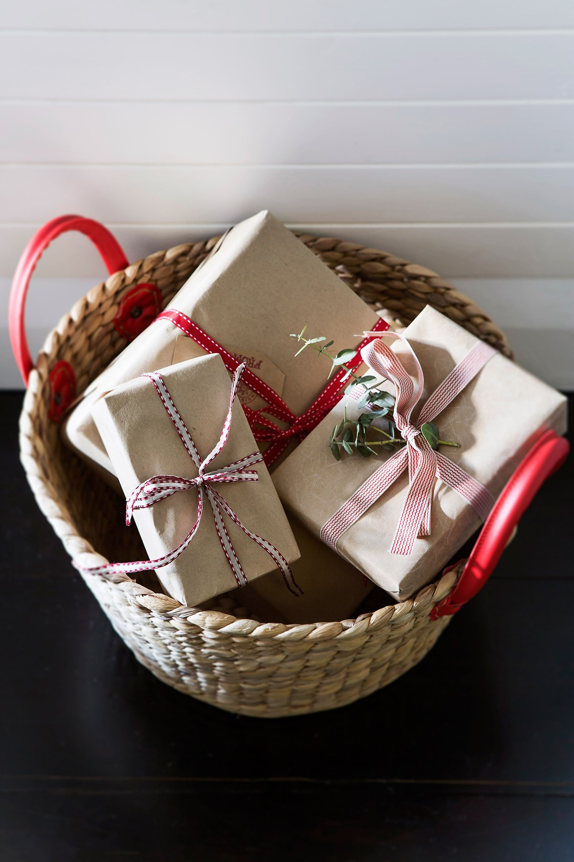 Keep a basket or bin nearby on Christmas Day to keep all the wrapping paper and packaging from covering your entire home.