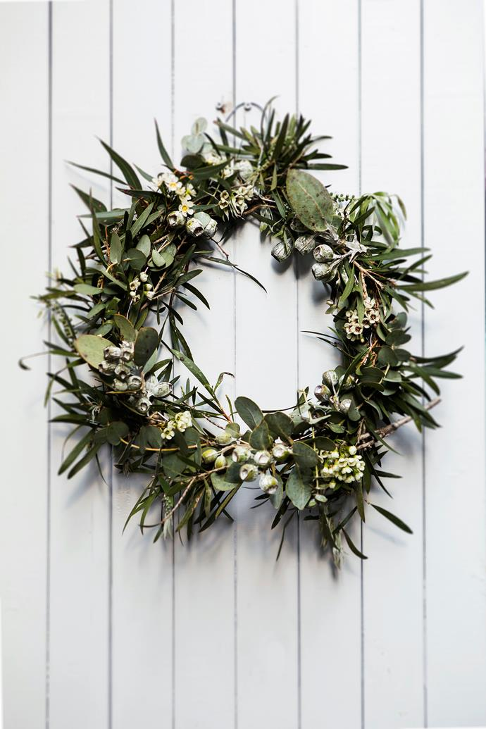 A craft lover, homeowner Catherine fashioned the festive wreath by adorning a wire coat hanger with native foliage.