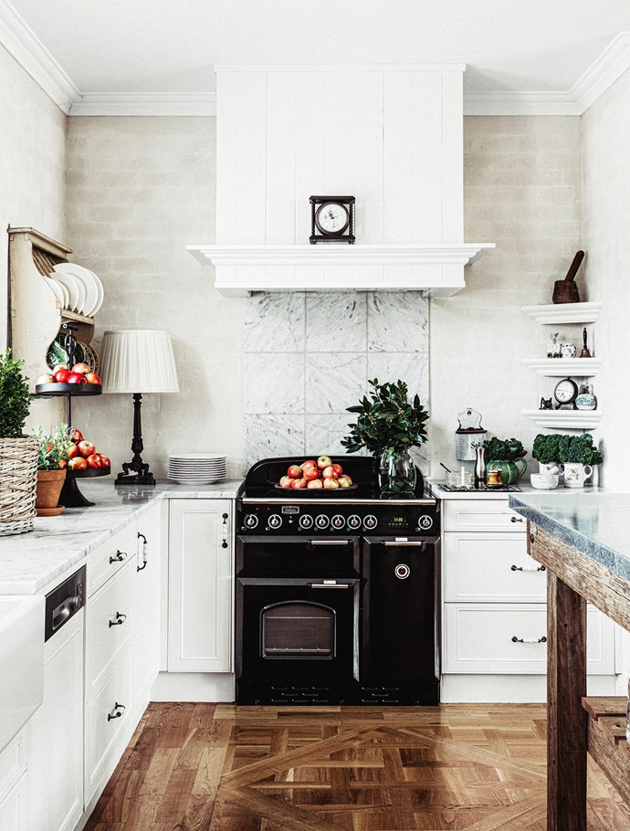 "Classic kitchen in white with marble countertops and splashback. **Plate rack and plates** from [Suzie Anderson Home](http://suzie-anderson-home.myshopify.com/?utm_campaign=supplier/|target=""_blank""). **Door hardware** from [Mother of Pearl & Sons](http://motherofpearl.com/?utm_campaign=supplier/