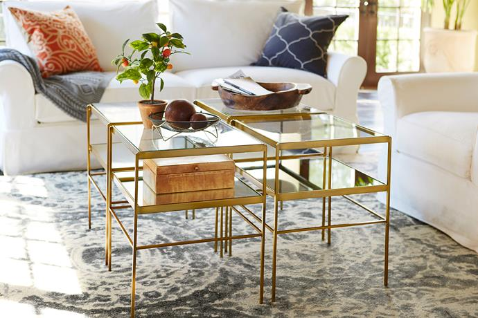 "Use one as a side table or group them together for a showstopping coffee table. Either way, the mirrored shelf and slimline brass design will take your living room upmarket. Leona cube **table**, $399, from [Pottery Barn](http://www.potterybarn.com.au/leona-glass-metal-onesie-cube|target=""_blank""
