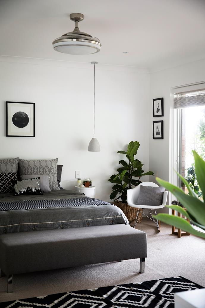 """A simple pendant light makes a clever alternative to a bedside lamp. Dianne says the Eames rocking chair beside the bed is one of her best buys. """"I have eyed off this chair for so long, and finally found the perfect space to put it."""""""