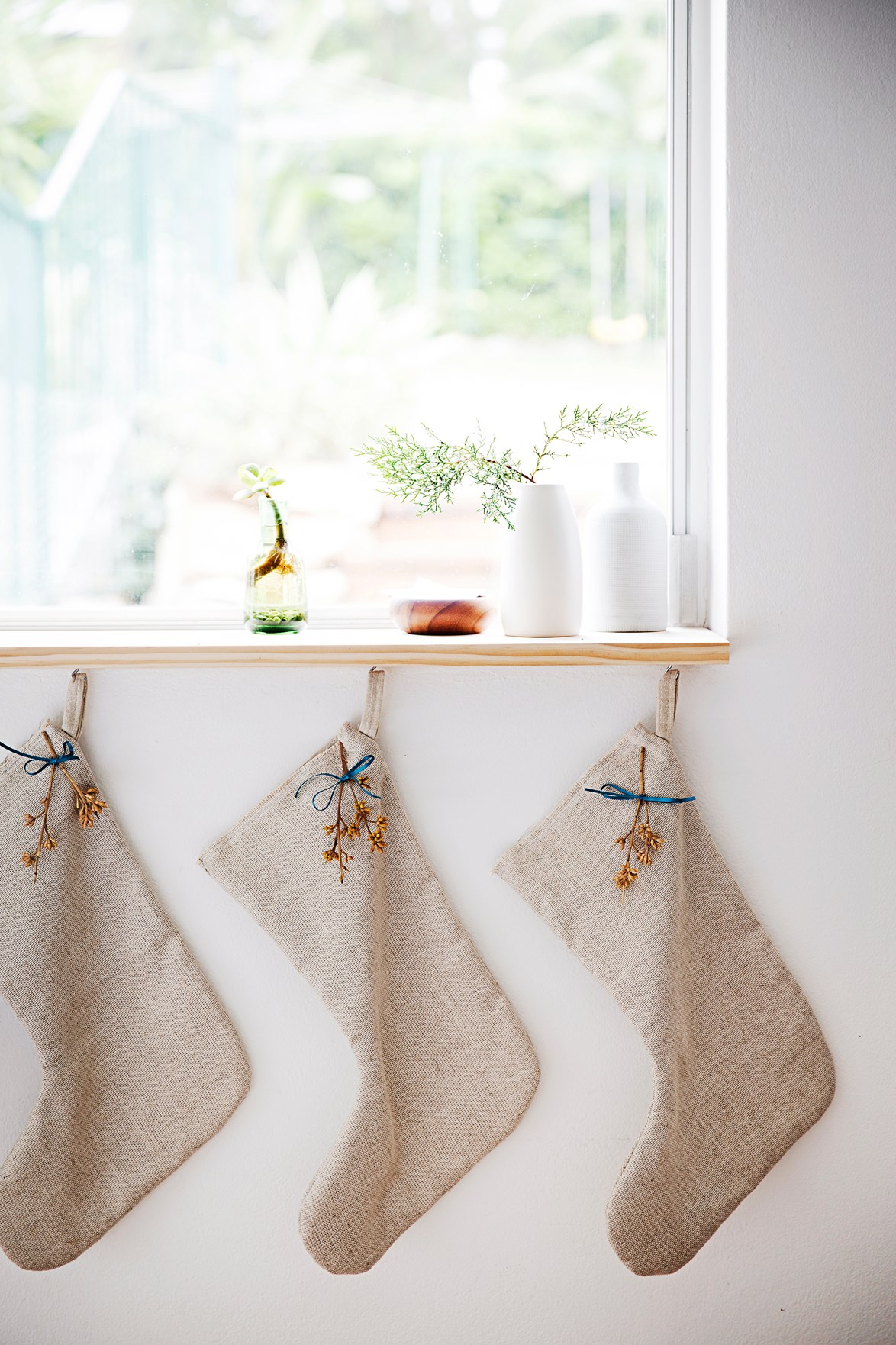 Natural linen stockings and with a eucalyptus sprig from the backyard create an Aussie Christmas feel.