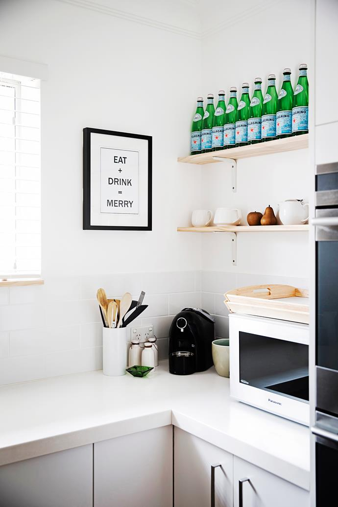 """""""I love using timber to add warmth to an all-white kitchen,"""" Dianne says. Knick knacks sit on shelves next to a framed **print** from [Little Fish Creations](http://www.littlefishcreations.com.au/?utm_campaign=supplier/