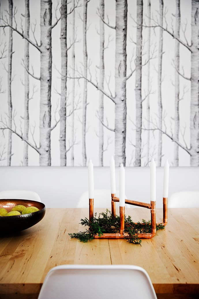 """The candelabra centrepiece is made from copper pipes and fittings and [Ikea](http://www.ikea.com/?utm_campaign=supplier/