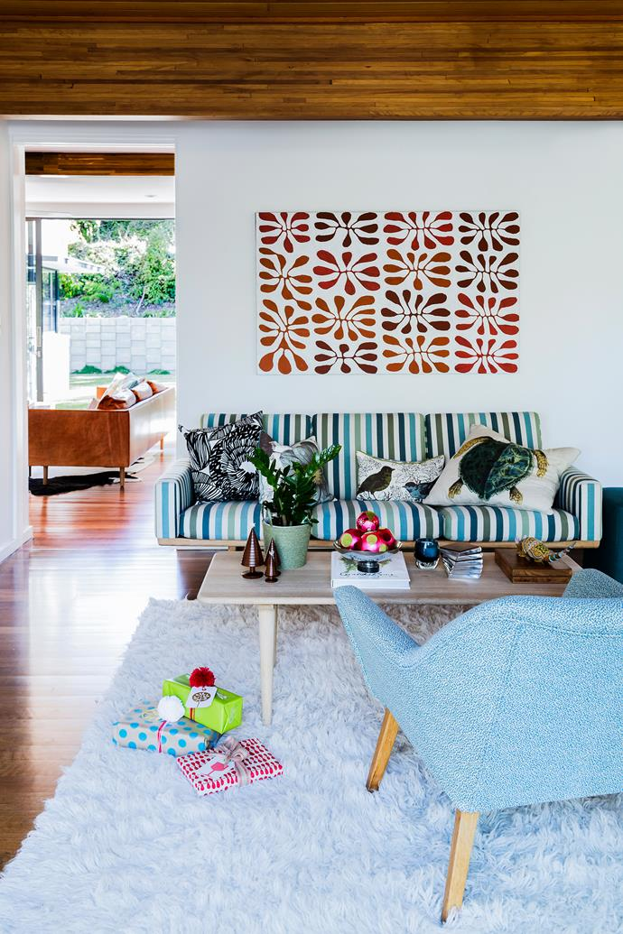 "Though 'formal', Kylie wanted a relaxed style in this living room. The vintage 1950s Grant Featherston armchair was a gift. **Sofa** from [Great Dane Furniture](http://www.greatdanefurniture.com/?utm_campaign=supplier/|target=""_blank""). **Artwork** by Mitjili Napanangka Gibson. **Leather sofa** (through doorway) from [Jardan](http://www.jardan.com.au/?utm_campaign=supplier/