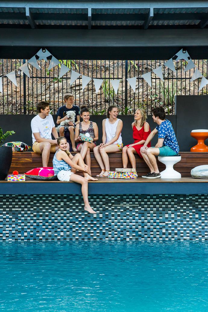 "Max (second from left) and Dixie (on bottom step), relax with relatives and friends. Pool **coping** in sandblasted basalt by [The Pool Tile Company](http://www.pooltile.com.au/?utm_campaign=supplier/|target=""_blank""). Kartell Rochetto **stools** from [1stdibs](https://www.1stdibs.com/?utm_campaign=supplier/