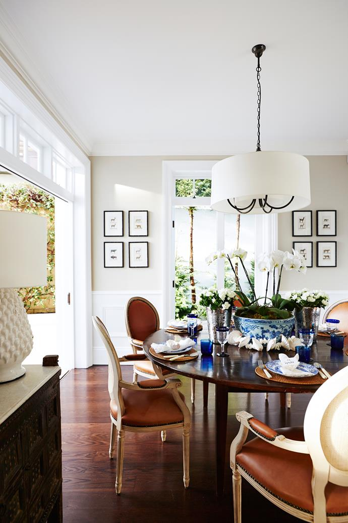 "Symmetry is the order of the day in this formal dining room. Lynda had the chairs reupholstered in rich tan leather. **Pendant light** from [Magins](http://magins.com.au/?utm_campaign=supplier/|target=""_blank"")."