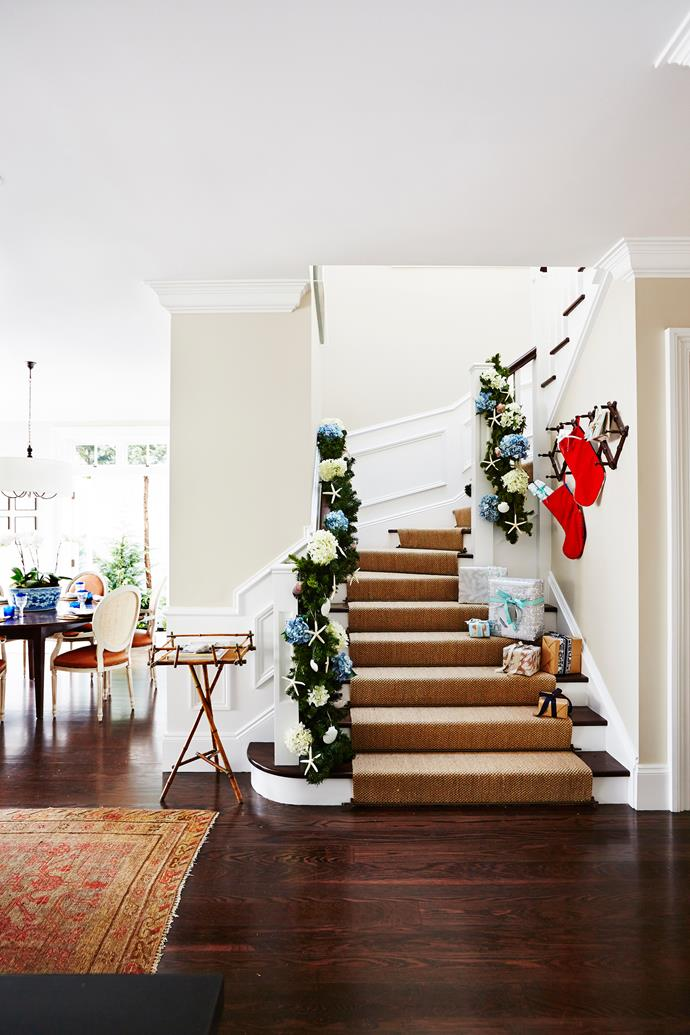 "**Pine garlands** and **faux flowers** from [Florabelle](https://www.florabelle.com.au/?utm_campaign=supplier/|target=""_blank"") cascade down the stairs. **Shell ornaments** from [My Island Home](http://www.myislandhome.com.au/?utm_campaign=supplier/