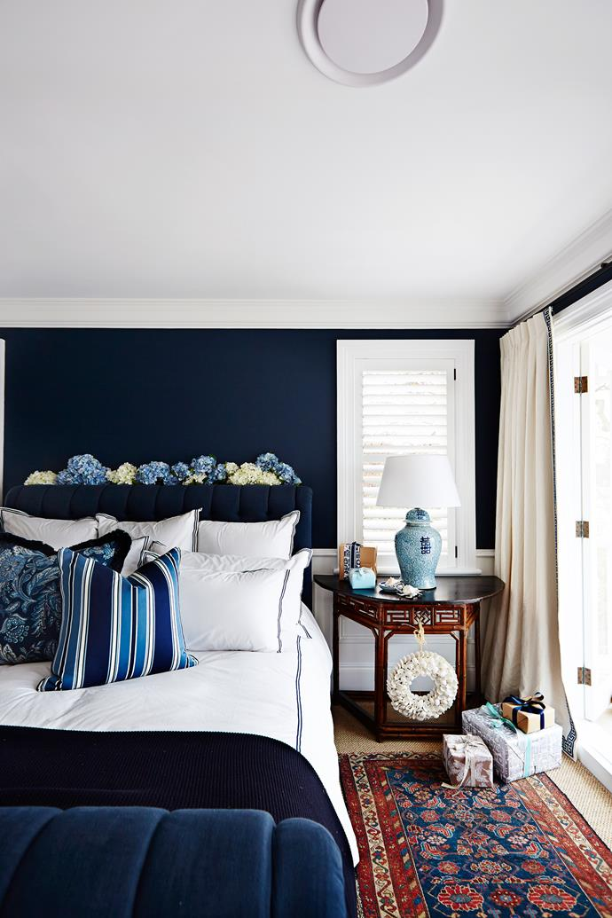 """I just love indigo,"" says Lynda. The **bedhead** in the master bedroom is upholstered in [Designers Guild](https://www.designersguild.com/?utm_campaign=supplier/