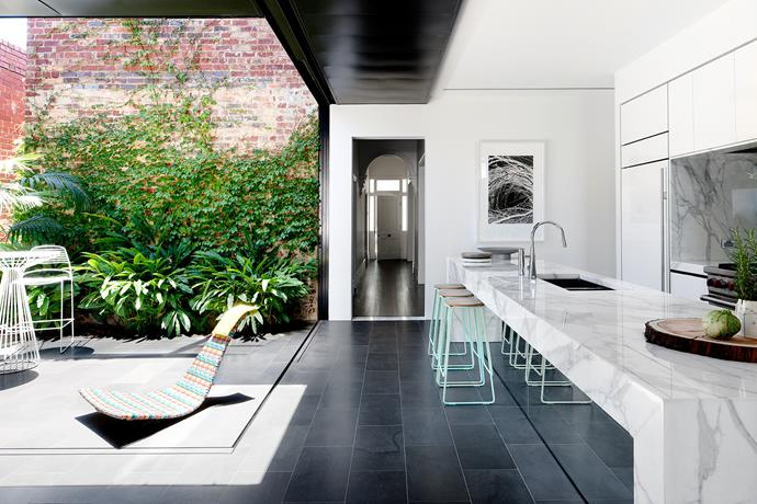 """The kitchen opens to the side courtyard. 'Smed' **stools** from [Great Dane Furniture](http://greatdanefurniture.com/?utm_campaign=supplier/