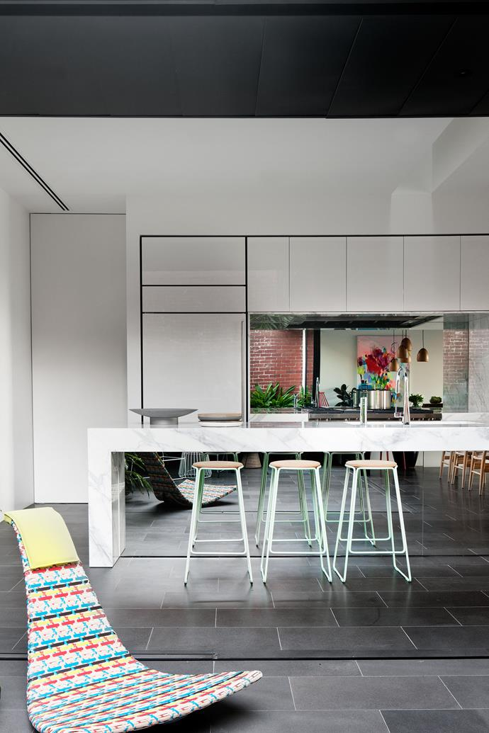 """The mirrored kitchen island amplifies the sense of space and brings the outside in. 'Smed' **stools** from [Great Dane Furniture](http://greatdanefurniture.com/?utm_campaign=supplier/