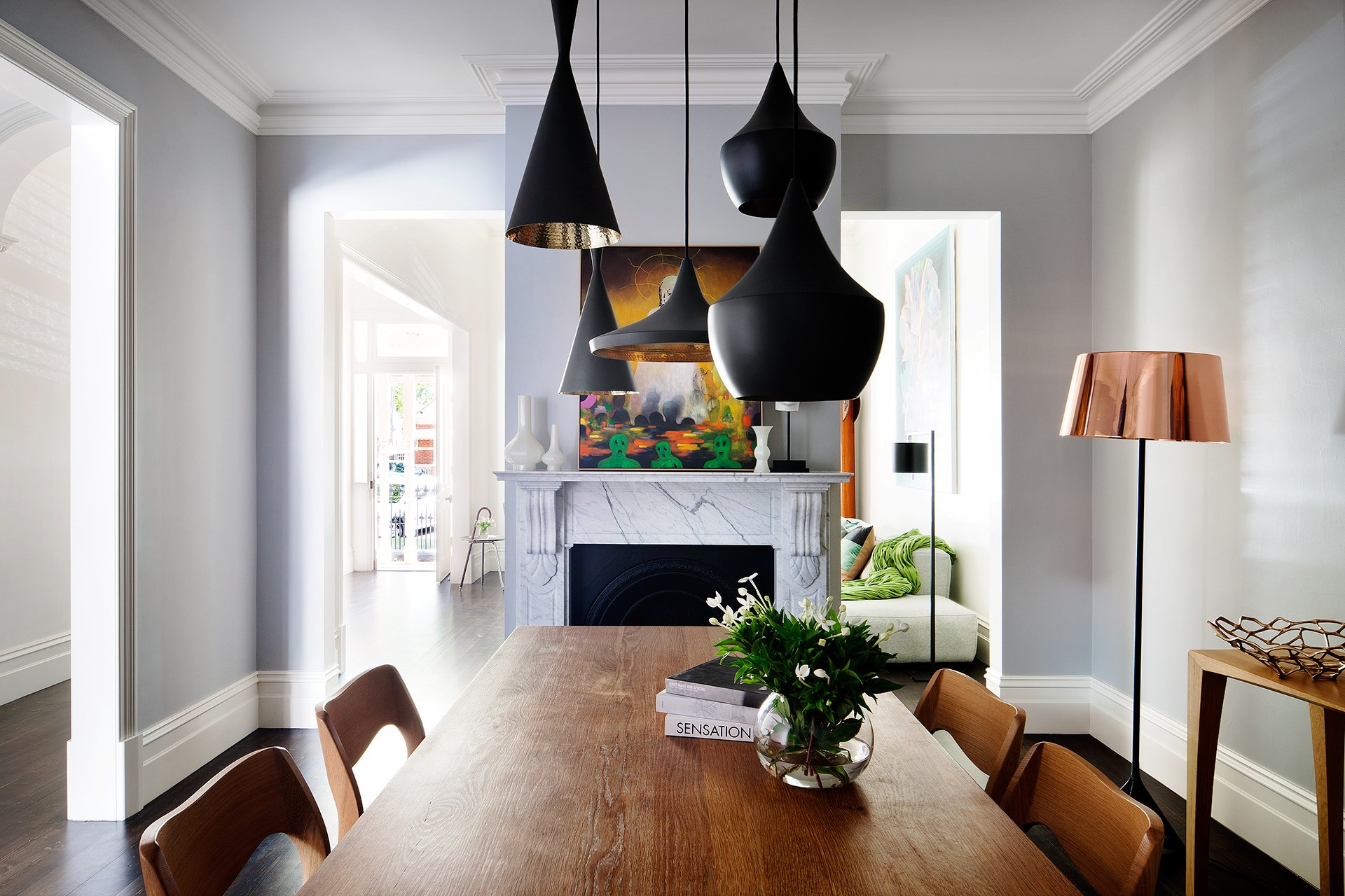 "A cluster of 'Beat' pendant lights by Tom Dixon from [Dedece](http://www.dedece.com/?utm_campaign=supplier/|target=""_blank"") adds some modern flair to this Victorian-era room. Find out more about this [ultra-modern addition to a heritage home](http://www.homestolove.com.au/ultra-modern-addition-to-a-heritage-house-2551