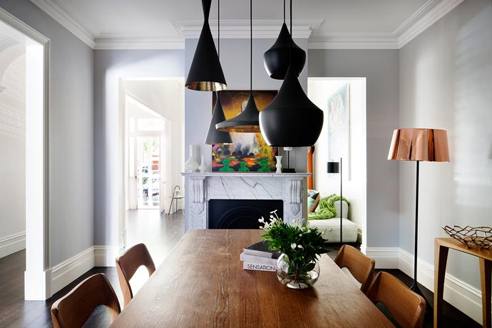 "A cluster of 'Beat' pendant lights by Tom Dixon from [De De Ce](http://dedece.com/?utm_campaign=supplier/|target=""_blank"") adds some modern flair to this [Victorian-era heritage home](http://www.homestolove.com.au/ultra-modern-addition-to-a-heritage-house-2551/?utm_campaign=supplier/