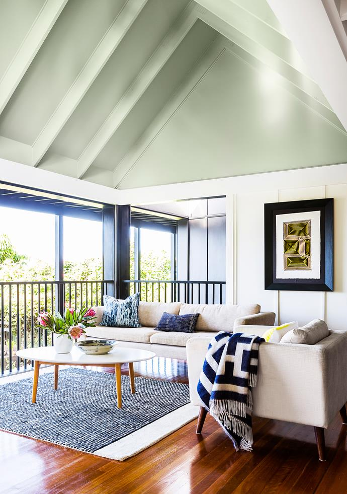 """The extension reinstates the idea of the back verandah, which previous owners had enclosed. The 'sleep-out' is ideal for the Queensland climate. """"It looks and feels like a verandah with the added benefit of being able to be closed up when needed,"""" says Stuart. **Sofa** and **armchair** from [Dare Gallery](http://www.daregallery.com.au/?utm_campaign=supplier/