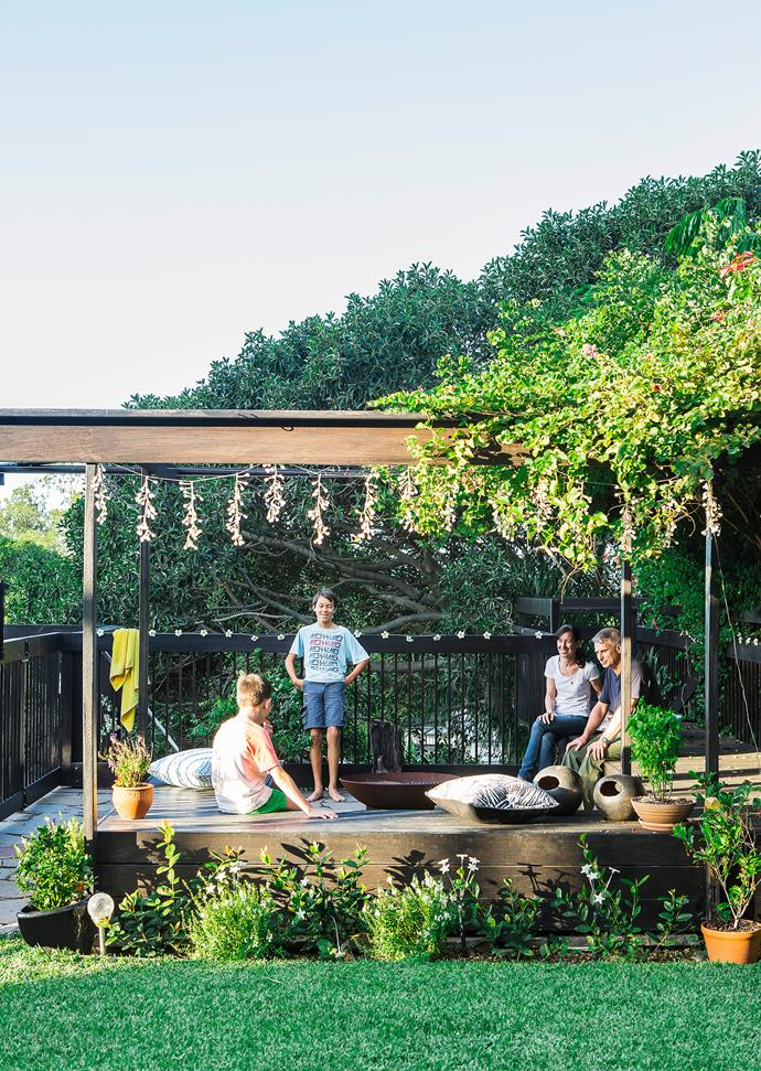 """Owners Anna and Jason with Matthew (left) and Alexander. The neighbour's bougainvillea shades the pergola, a stop-gap until the couple's wisteria grows. Angelina **fire pit** from [Robert Plumb](http://robertplumb.com.au/?utm_campaign=supplier/