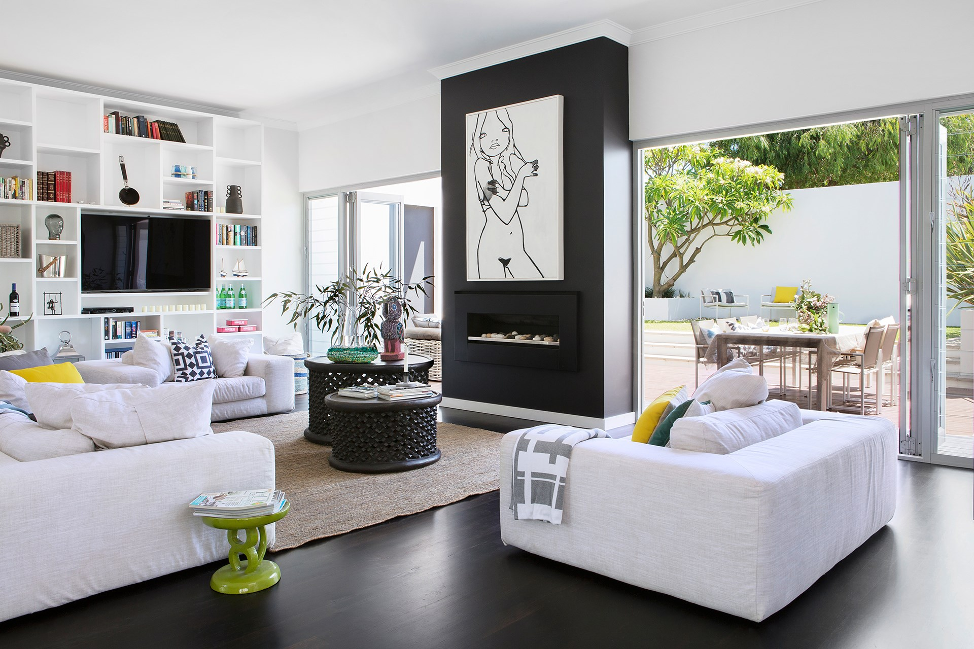 Two carved bamileke stools with a strong textural appeal are re-purposed as a coffee table in this [open plan family home](http://www.homestolove.com.au/open-plan-living-at-its-best-2557). Photo: Angelita Bonetti / *Australian House & Garden*