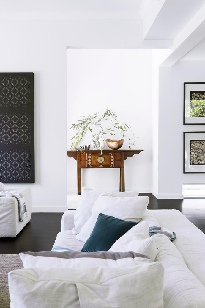 """An antique Korean console delivers warmth in this monochrome space. Lantern **screen panels** from [Eco Outdoor](https://www.ecooutdoor.com.au/?utm_campaign=supplier/