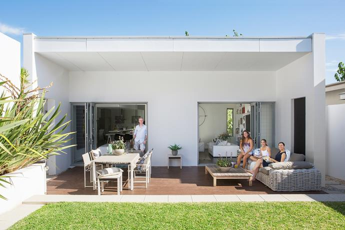 """""""Spring is the best time to enjoy this space,"""" says Nicky, pictured above with Emily (left) and Elina. """"We open up the doors and make the most of it throughout the day."""" **Sofa** from [Blu Peter](http://www.blupeter.com.au/?utm_campaign=supplier/