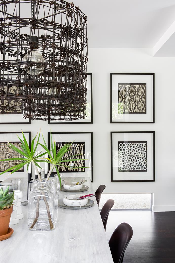 Framed **artworks** from [Designer Boys Collections] add drama in the dining area.