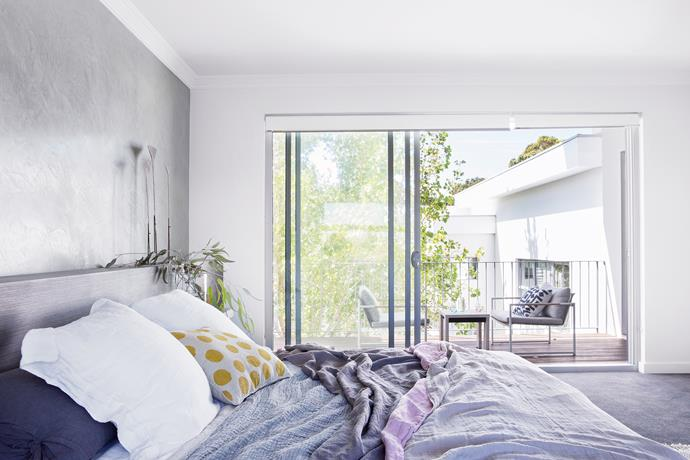 """An interesting textural effect has been achieved with a concrete-effect plaster wall and soft Belgian bedlinen. **Bedlinen** and **throws** from [Pure Linen](http://www.purelinen.com.au/?utm_campaign=supplier/