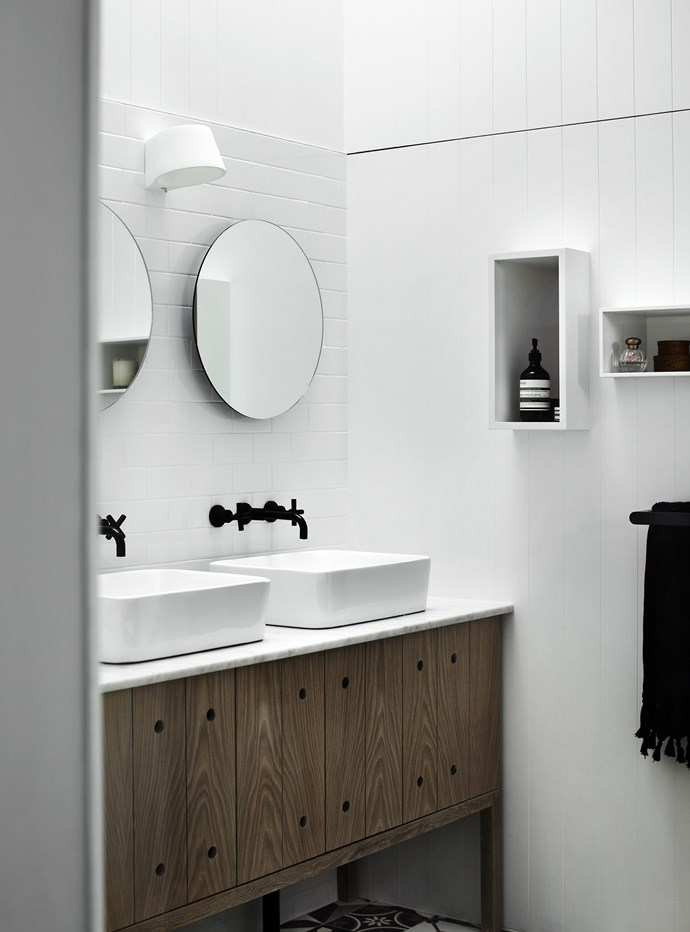 As in the rest of the house, natural timber adds warmth to the largely black-and-white scheme.