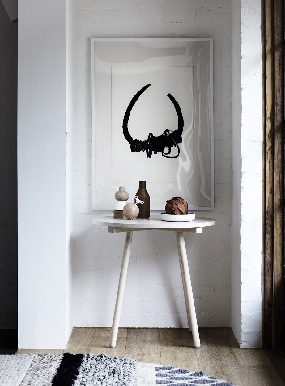 At the very least, you want a place to plonk your keys when you arrive home. This compact nook by the front door houses a small table and a statement artwork to provide a simple yet stylish point of entry.