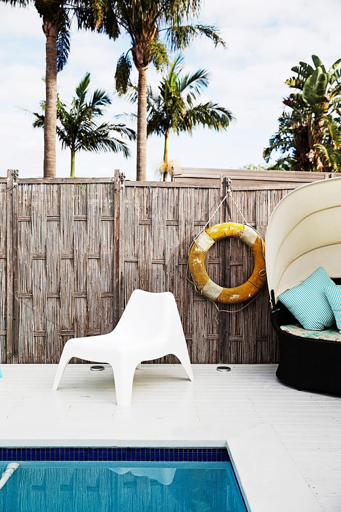 "The pool area, sandwiched between the verandah and cabana, is clad in white decking to tie in with the interior. Bamboo fencing adds a beachy feel. The [Ikea](http://www.ikea.com.au/?utm_campaign=supplier/|target=""_blank"") **easy chair** is the perfect poolside piece."