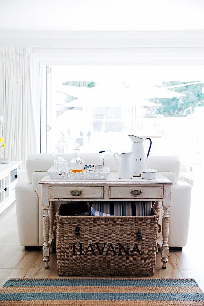 A display of jugs and decanters add interest to Christiana's Hamptons-style look.