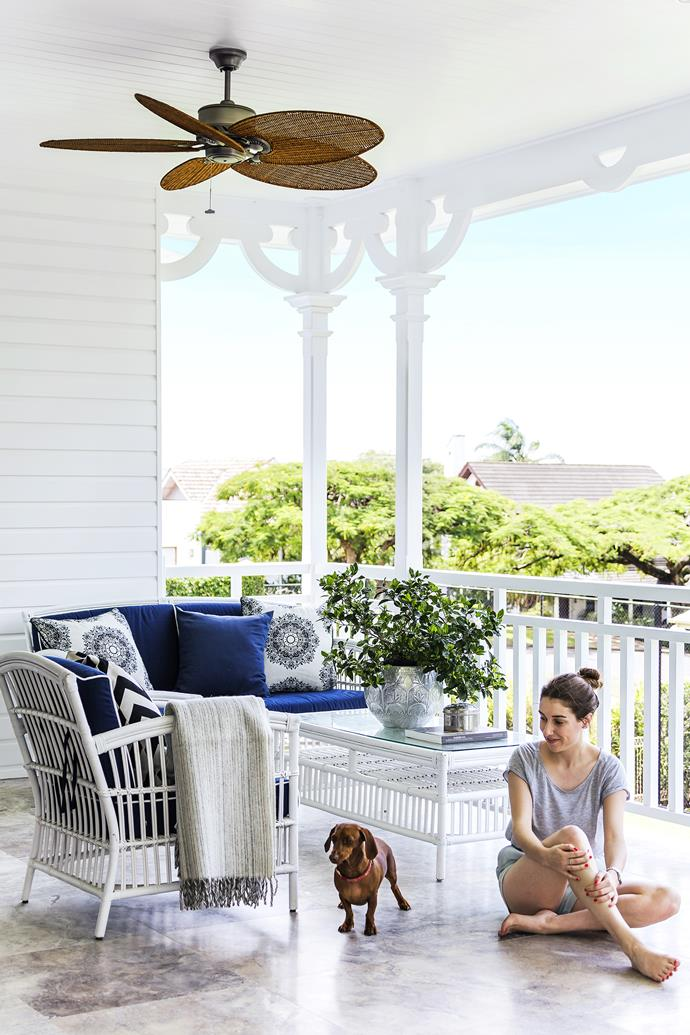 "Grace and her miniature dachshund, Coco, enjoy the shade of the front verandah. **Ceiling fan** from [MyFan](http://www.myfan.com.au/?utm_campaign=supplier/|target=""_blank""). **Cushions** from from [Highgate House](http://www.highgatehouse.com.au/?utm_campaign=supplier/