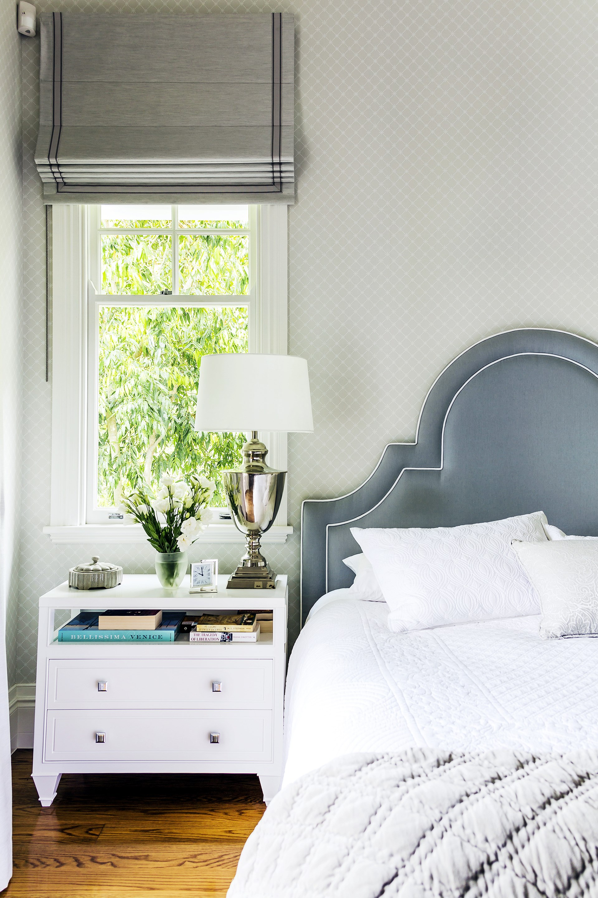 "A 'Portman'-shaped bedhead with white piping suits this [classic Queenslander](http://www.homestolove.com.au/classic-queenslander-updated-for-family-living-2577|target=""_blank"") to a tee. Photo: Maree Homer / *Australian House & Garden*"