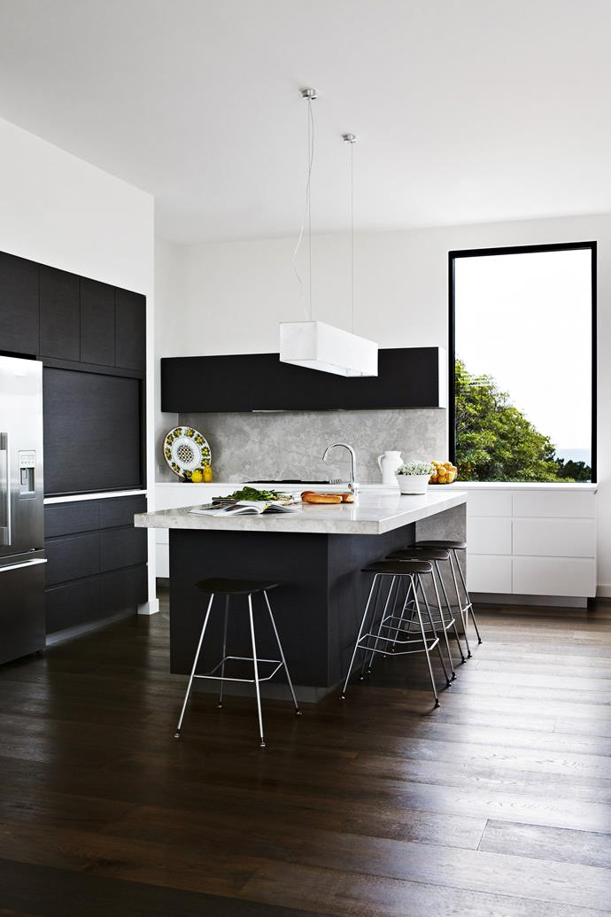 "A butler's pantry, to the left of the stove, keeps prep clutter contained so the island bench can be used for serving. **Ceramics** bought in Italy. **Splashback** and island **benchtop** made of silver travertine from [Beyond Tiles](http://www.beyondtiles.com.au/?utm_campaign=supplier/|target=""_blank""). Rear **benchtop** is Quantum Quartz in Luna White. Island bench and feature **cabinetry** finished in Navlam Arcadian Oak, [New Age Veneers](http://www.newageveneers.com.au/?utm_campaign=supplier/