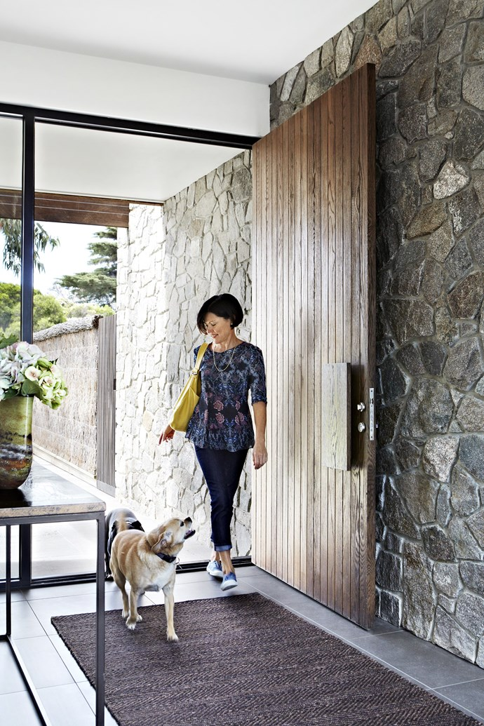 "Owner Venetia Bowen and pugalier Charlie make a grand entrance. The **stone wall** is made from granite sourced from [Hillview Quarries](http://www.hvq.com.au/?utm_campaign=supplier/|target=""_blank""). Earth Collection Serengeti **rug**, [Armadillo&Co](http://armadillo-co.com/?utm_campaign=supplier/