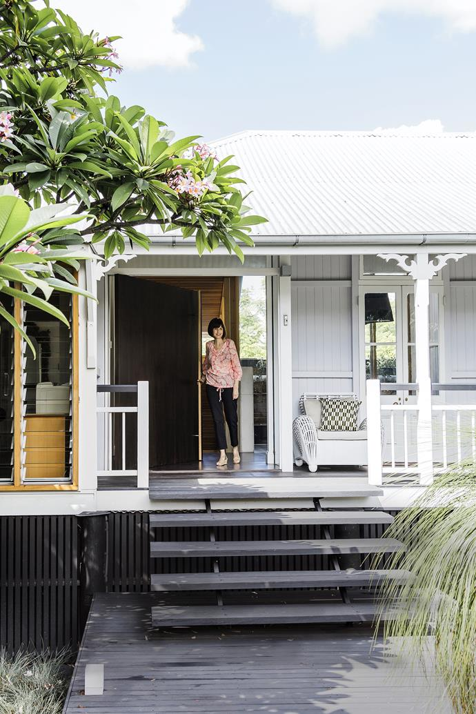"""Homeowner Mary Zahos on the porch of the original weatherboard cottage. The oversize front door offers the only hint of the contemporary design inside. **Chair** from [St Barts](http://www.st-barts.com.au/?utm_campaign=supplier/