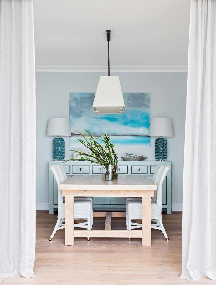 Try one large artwork centred above a sideboard, then place two matching table lamps on either side. Photo: Felix Forest / bauersyndication.com.au
