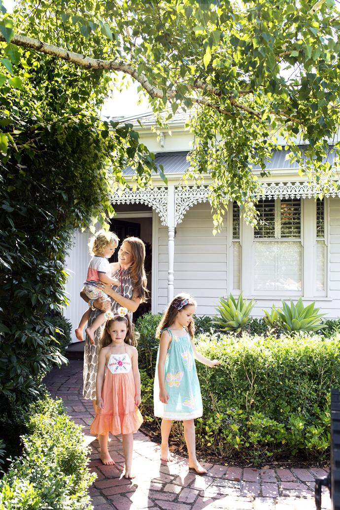Owner Janet and her children George, Daisy and Matilda in front of their Melbourne home with its unassuming Victorian cottage façade.