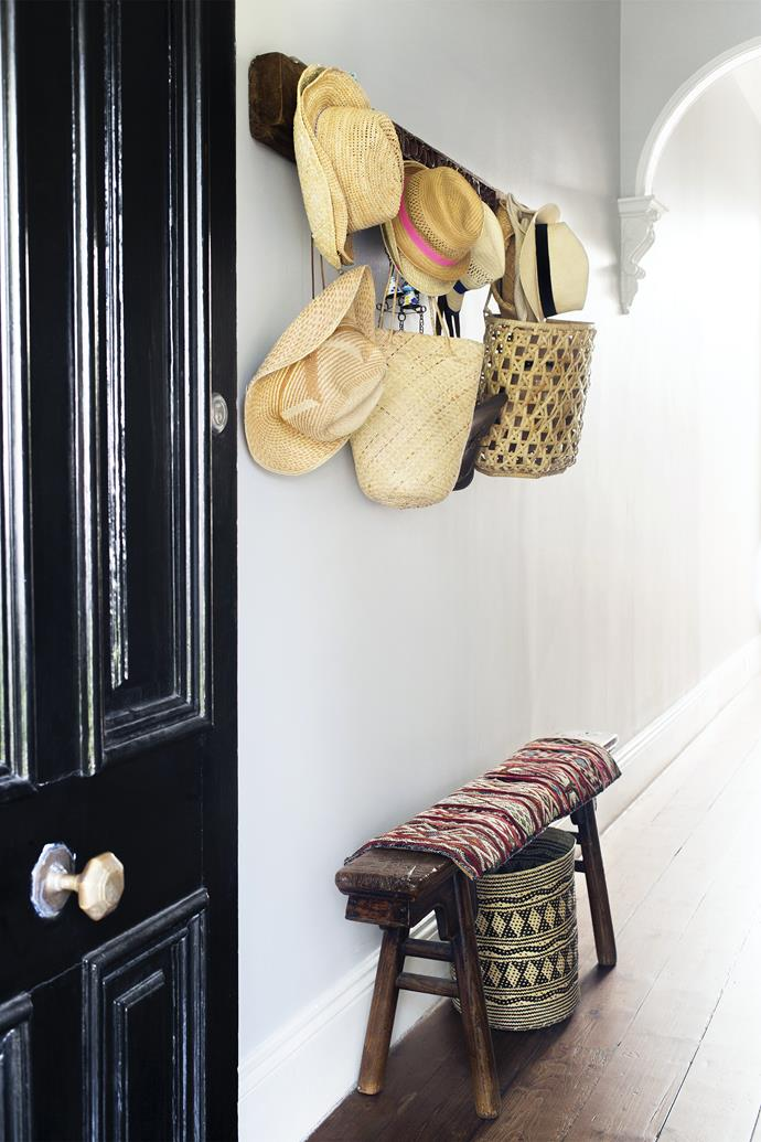 """Inside the glossy black front door, Janet's Moroccan textiles are used to cover the seat in the entrance. This front part of the house, with its original hallway and two bedrooms, has been lovingly restored with its period features intact by interior designer [Ali Ross](http://alirossdesign.com/?utm_campaign=supplier/