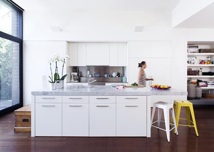 """Janet walks through the generous kitchen at the rear of the house, designed by [Ali](http://alirossdesign.com/?utm_campaign=supplier/