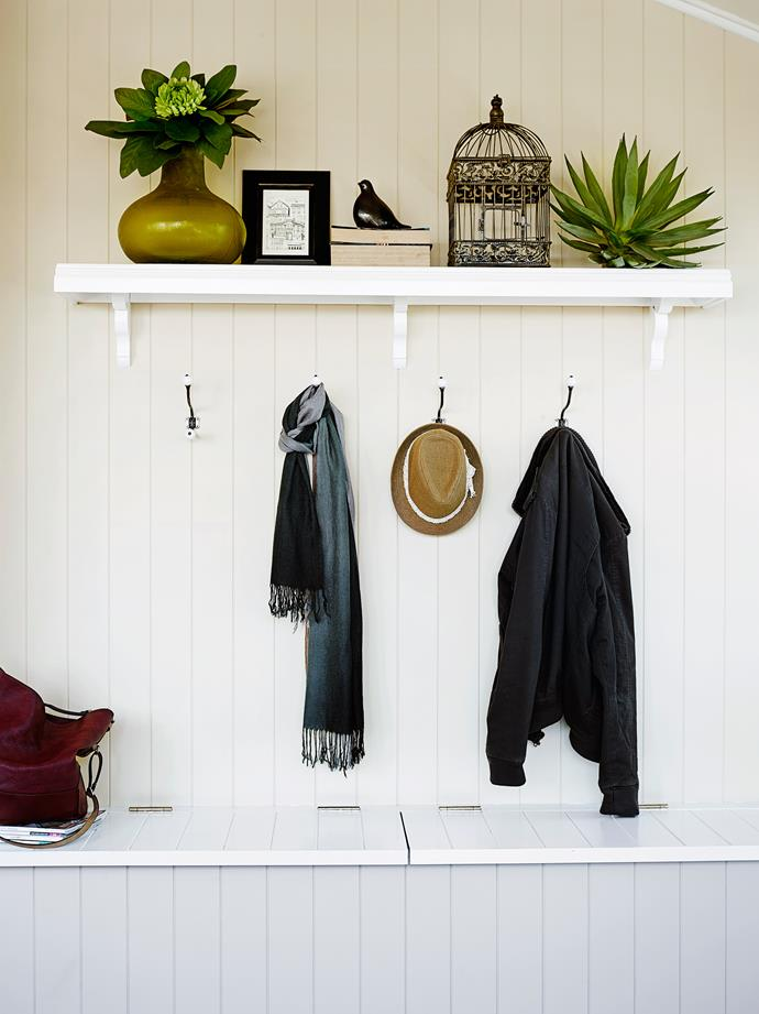 The verandah was a long and narrow room that Melissa divided in two to create a mudroom/entry on one side, and a family room for the children on the other. This is the wall that divides the spaces. The hooks are from a vintage store.