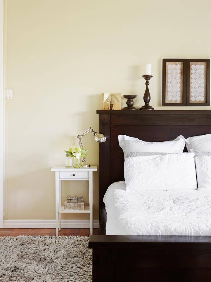 The bed originally had a mahogany stain but Melissa sanded it back and applied Black Japan for a contemporary feel.