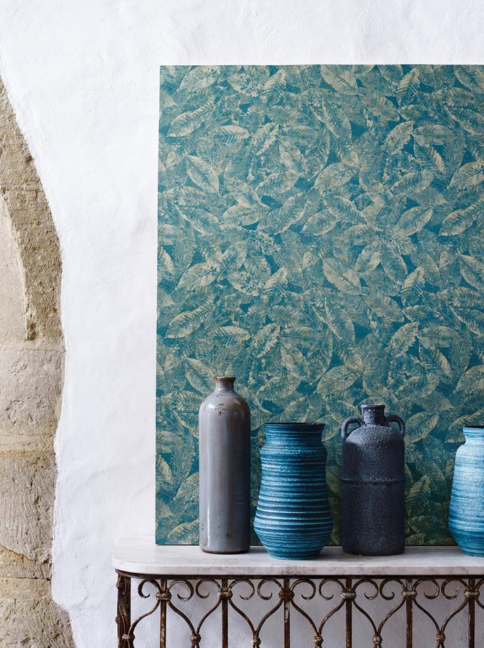 "This Osborne & Little Kayin Pasha leaf **wallpaper** in Colour 02 from [Seneca Textiles](http://www.senecatextiles.com/?utm_campaign=supplier/|target=""_blank"") is complemented with vessels in various shades of blue that emphasise the colour impact."