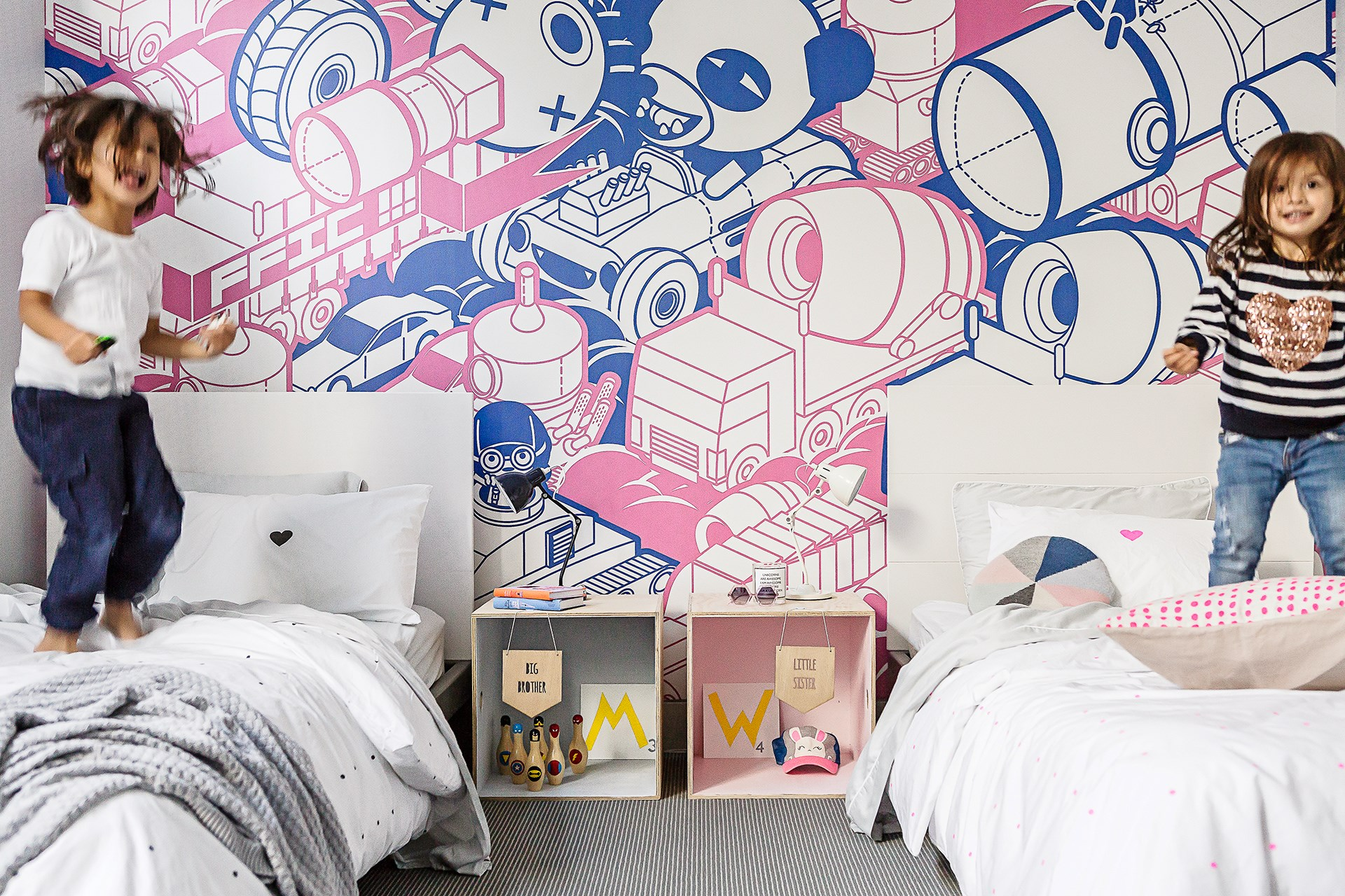 """A mural which combines pink and blue is the perfect compromise for the little boy and girl who share a bedroom in this [colourful townhouse](http://www.homestolove.com.au/gallery-amys-playful-family-townhouse-2637 target=""""_blank""""). Photo: Maree Homer"""