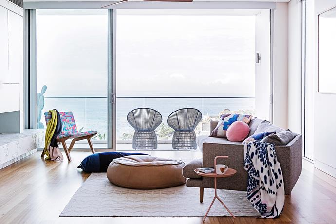"""The open-plan top floor is perfect for hosting parties. While the kids prefer the backyard, the adults gravitate towards the balcony and its ocean view. **Sofa** is from [Jardan](http://www.jardan.com.au/?utm_campaign=supplier/