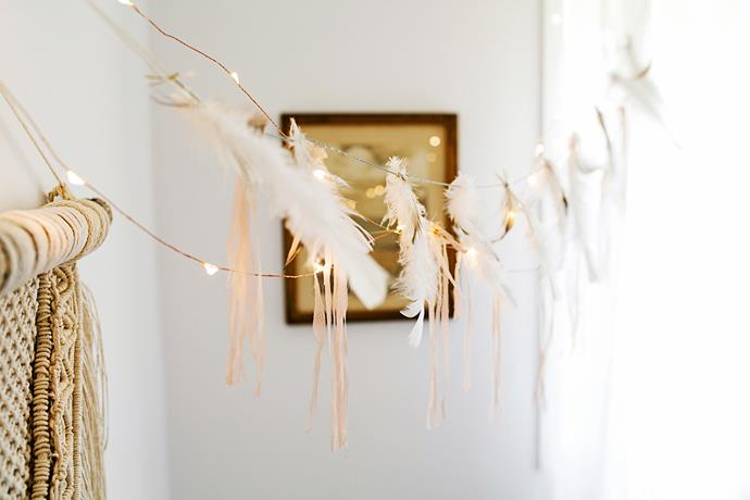 "A pretty feather bunting hangs above the bed in two-year-old Pearl's bedroom. ""I love that it's so understated, whimsical and soft,"" Sarah says."