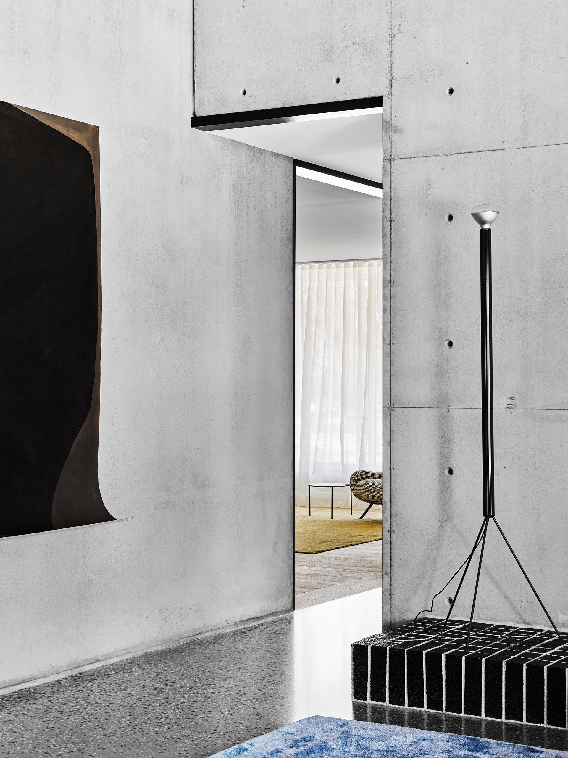 """Artistic elements are around every corner. In the living room, a [Flos](http://www.flos.com/?utm_campaign=supplier/