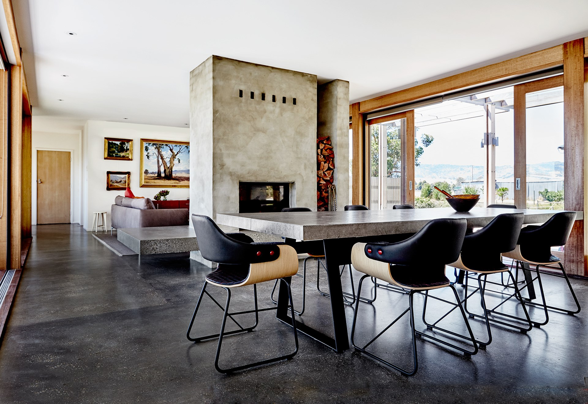 "The concrete tabletop and steel framework suggests subtle industrial glam in the dining room of this [luxury '70s farmhouse](http://www.homestolove.com.au/contemporary-revamp-for-70s-farmhouse-2640|target=""_blank""). *Photo: James Geer*"