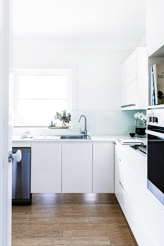A neutral kitchen that was large enough for the couple to entertain but didn't jar with Claudia's aesthetic sensibilities was one of the attractions of the duplex.