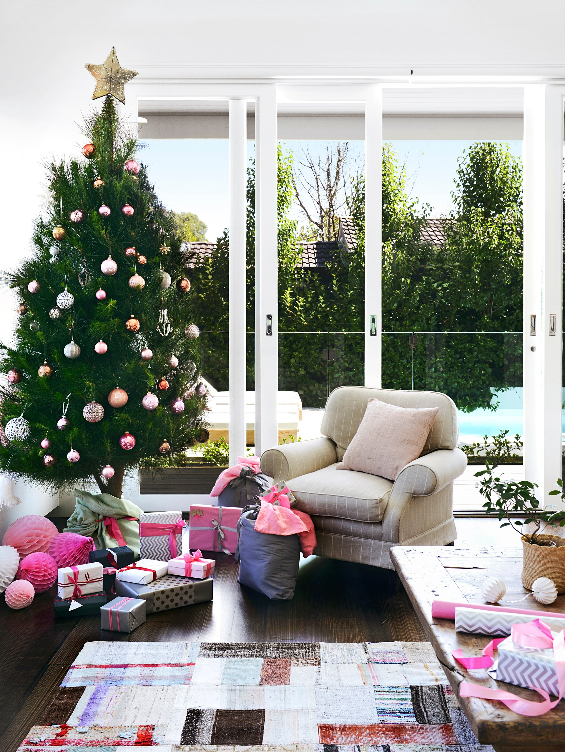 """A real Christmas tree adds a lively flair to the living room of this [weatherboard home in Melbourne](http://www.homestolove.com.au/old-cottage-becomes-a-stunning-family-home-2749