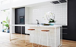 Black and white open-plan kitchen