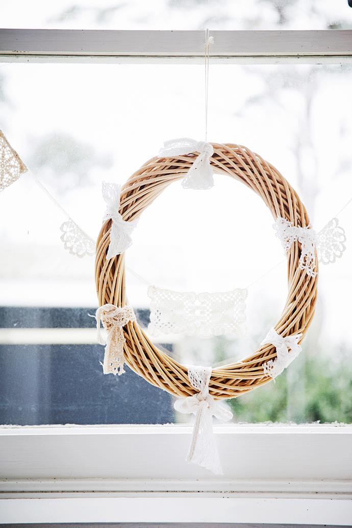 A cane wreath with lace remnants tied to it is a sweet window ornament.